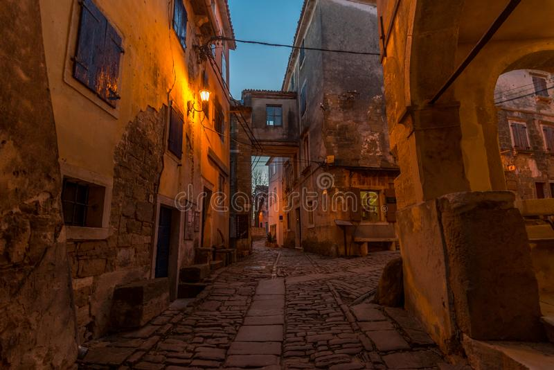 Groznjan Street at blue Hour. Street of Old Town Groznjan, Istria, Croatia, photographed with my Nikon D750 at Winter afternoon and blue Hour stock photography