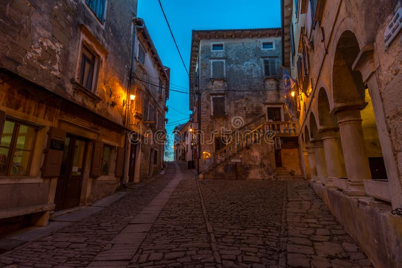 Groznjan Street at late afternoon. Street of Old Town Groznjan, Istria, Croatia, photographed with my Nikon D750 at Winter afternoon and blue Hour royalty free stock images
