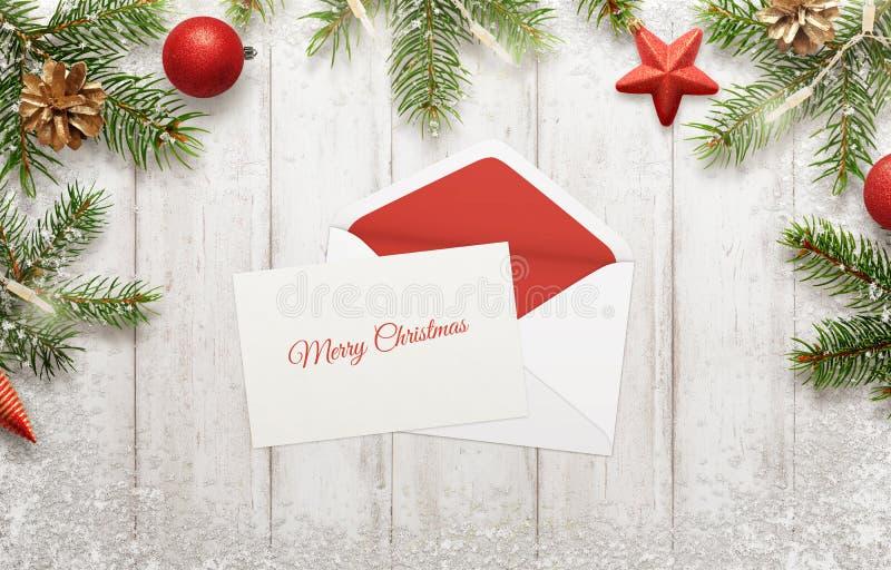 Gruß der frohen Weihnachten auf Weißbuch Umschlag dazu lizenzfreie stockfotografie