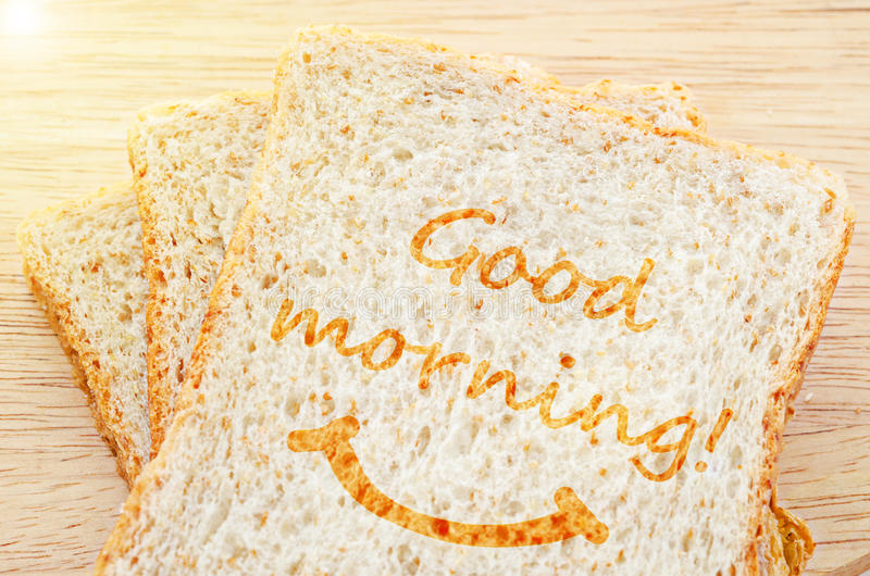 Gruß des gutenmorgens auf geröstetem Brotweizen stockfotografie