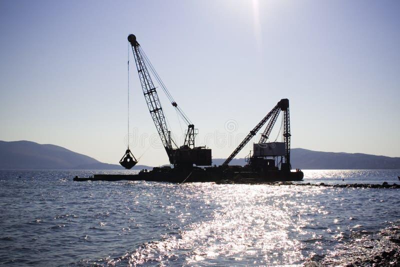 Gru di galleggiamento fotografie stock