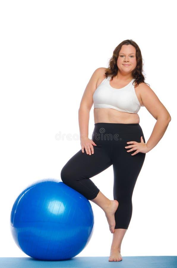 Gruba kobieta robi sprawności fizycznej obraz stock