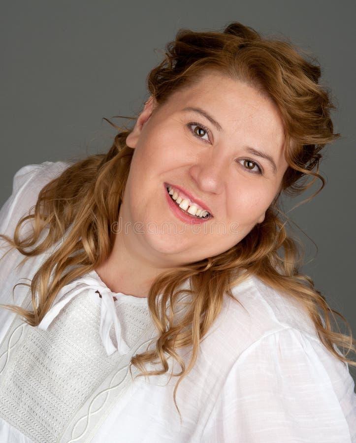 gruba uśmiechnięta kobieta zdjęcia stock