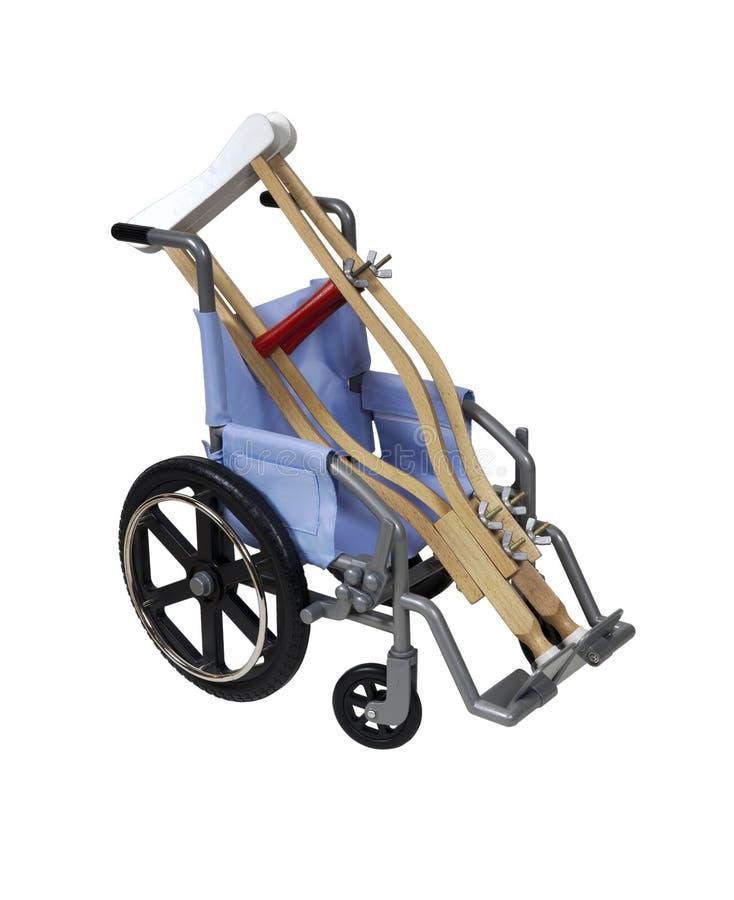 Grucce e sedia a rotelle immagine stock