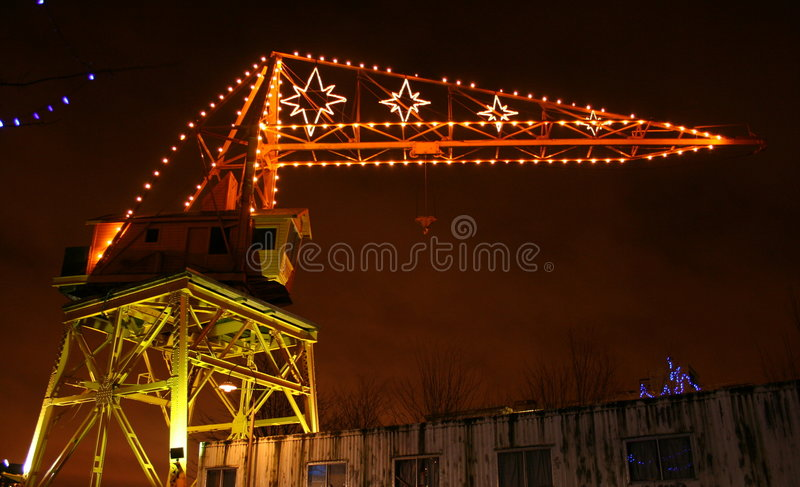 Grue avec des lumières de Noël photographie stock