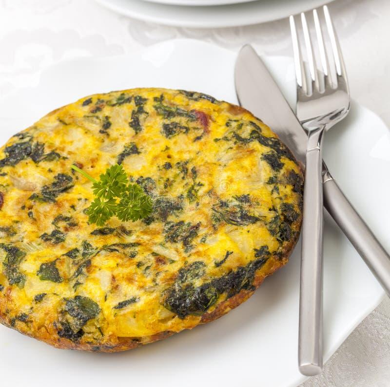Gruli i szpinaków omlet obrazy royalty free