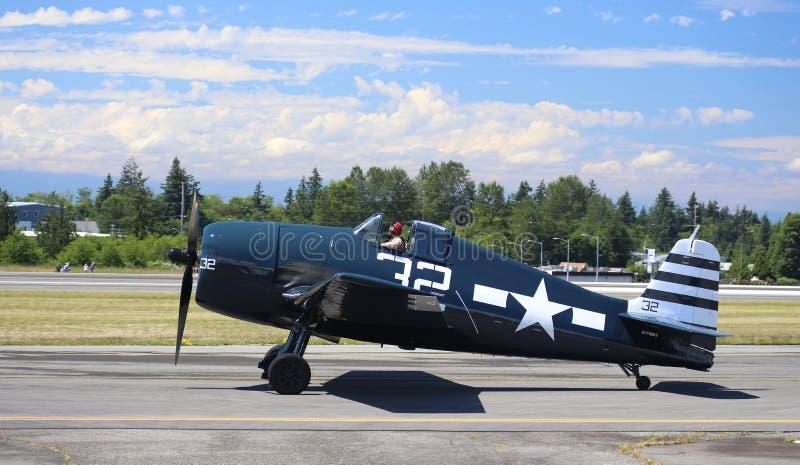 Grumman Hellcat. EVERETT - JUNE 29: A restored World War 2 Grumman F6F-5 Hellcat was seeing flying in the skies over Everett Paine Field on 29 June 2013 near stock photos