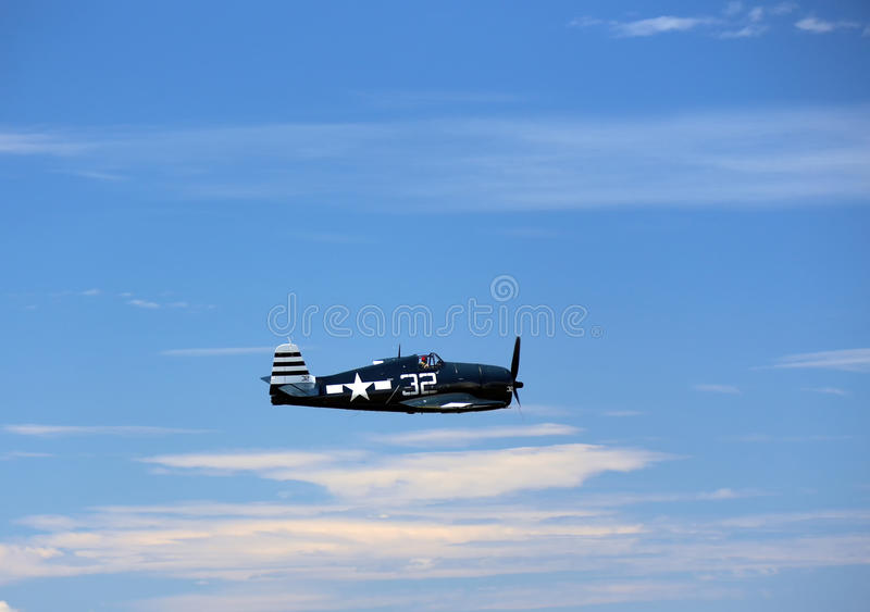 Grumman Hellcat. EVERETT - JUNE 29: A restored World War 2 Grumman F6F-5 Hellcat was seeing flying in the skies over Everett Paine Field on 29 June 2013 near royalty free stock photography
