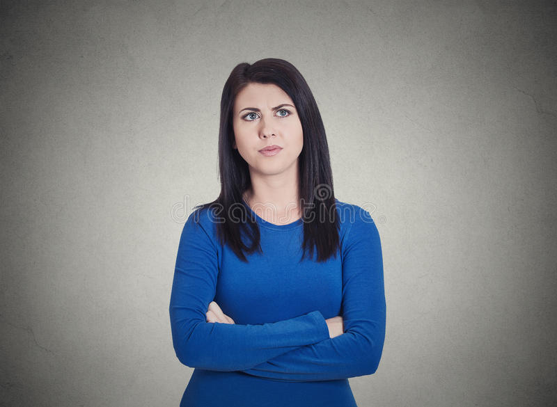 Grumpy annoyed, sad, unhappy, dissatisfied young woman stock photo