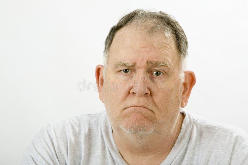 Grumpy big guy stock photo