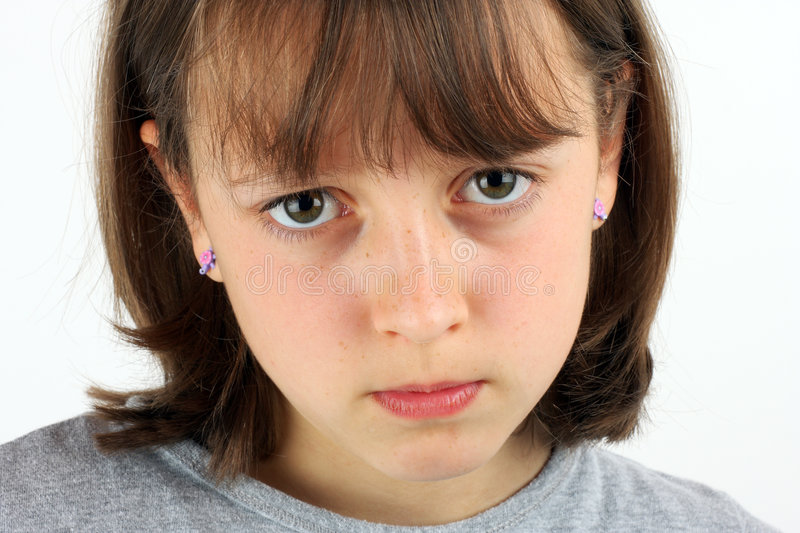 Grumpy girl. Girl in a bad mood against a white background royalty free stock photos