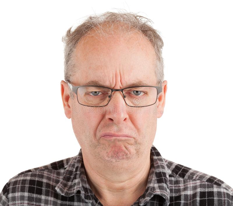 Grumpy Looking Man. This is a portrait of a grumpy middle aged man royalty free stock images