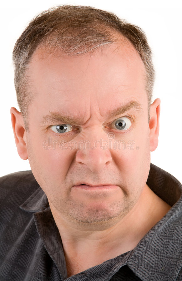 Grumpy Middle Aged Man. This is a portrait of a grumpy middle aged man royalty free stock image