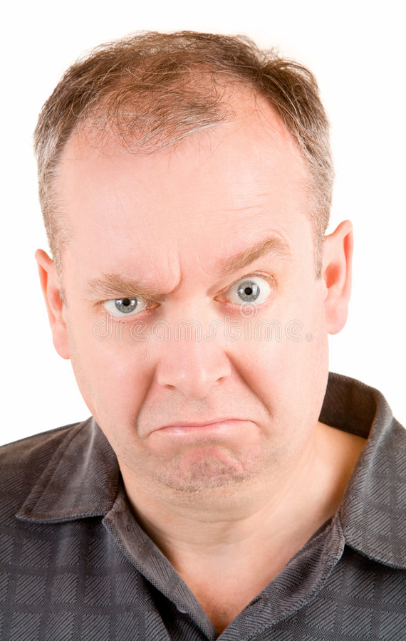 Grumpy Middle Aged Man. This is a portrait of a grumpy middle aged man royalty free stock images