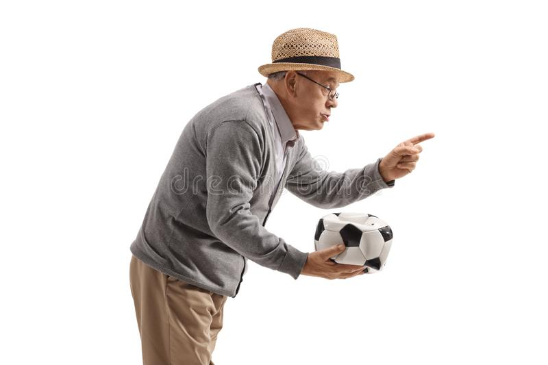 Grumpy old man holding a deflated football and scolding someone. Isolated on white background stock images