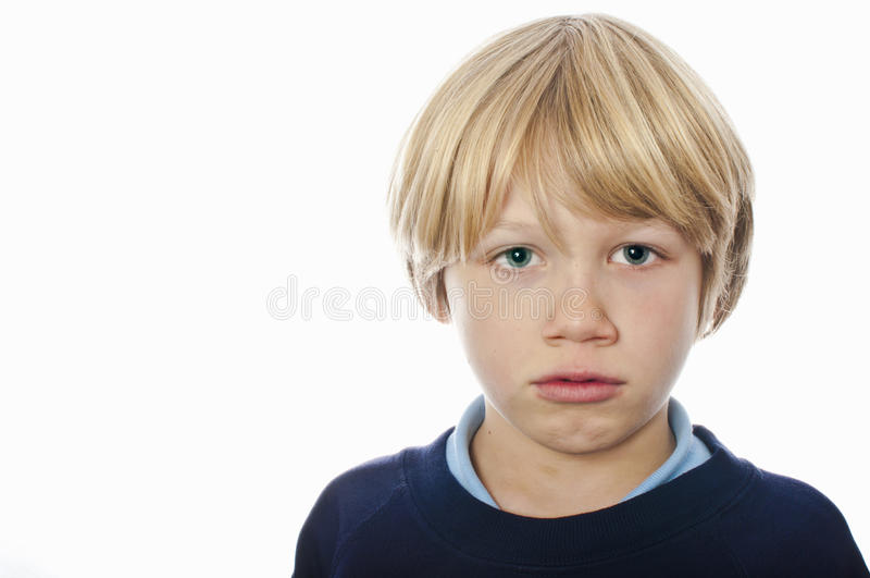 Grumpy school boy royalty free stock images