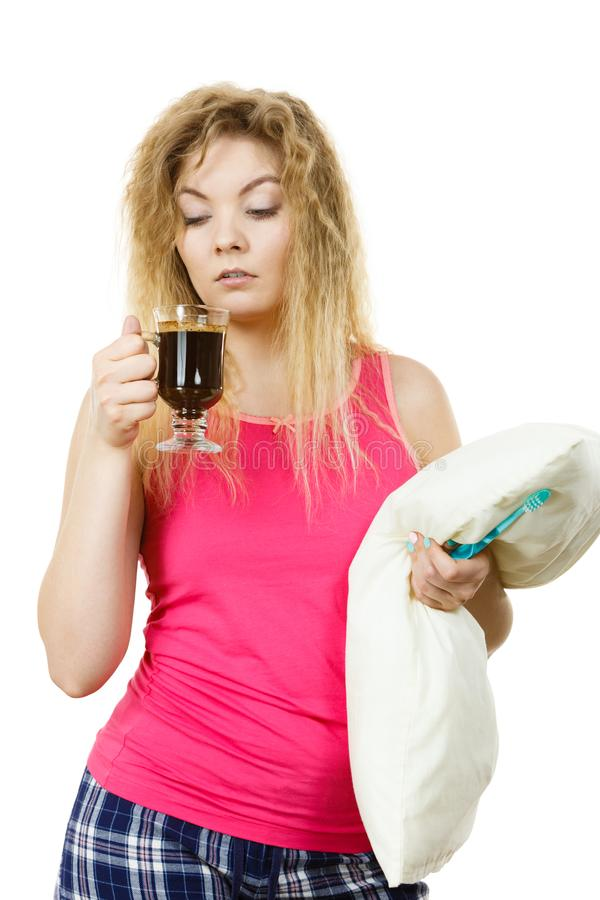 Tired woman drinking her morning coffee stock photography