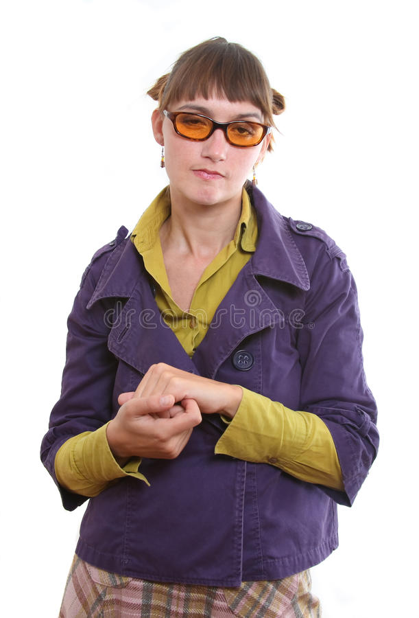 Grumpy woman. Grumpy and deceitful woman rubbling her hands in contempt royalty free stock photo