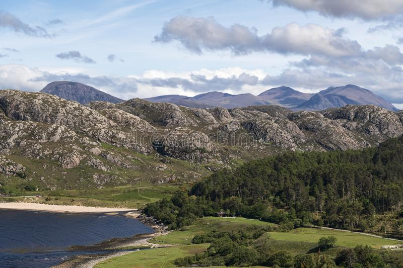 Grunard Mountains. A summers day by the sea and beach at Gruinard Bay in Wester Ross, Highlands, Scotland stock images