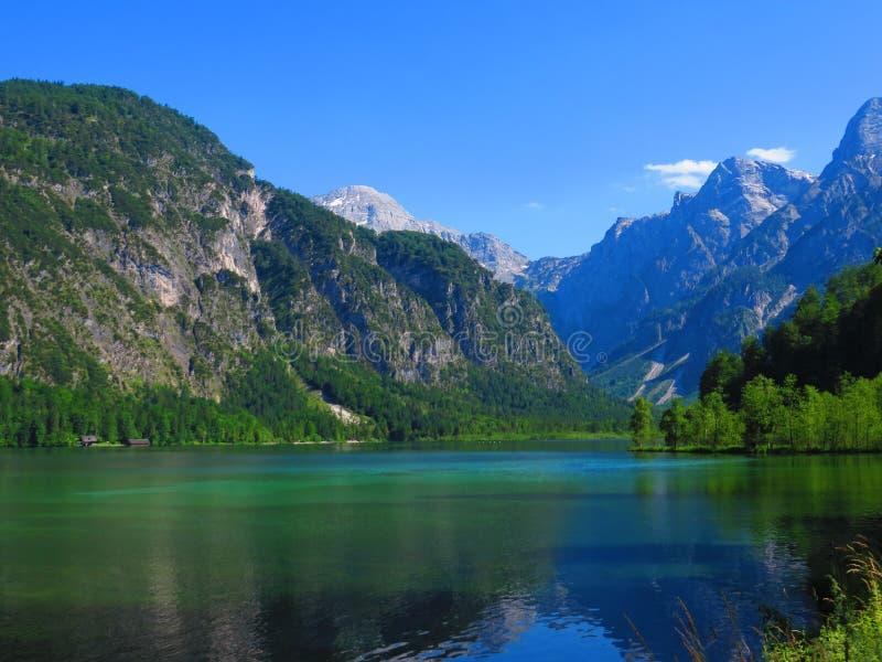 Mountains reflecting over a lake royalty free stock photos