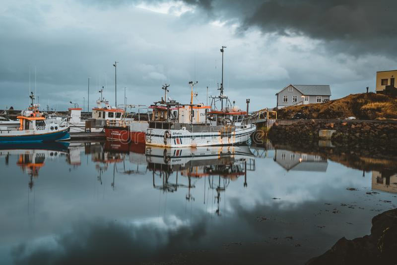 Grundarfjordur, Iceland - 03 January 2019: Harbor with motionless boats during the twilight of the afternoon, Kirkjufell stock images