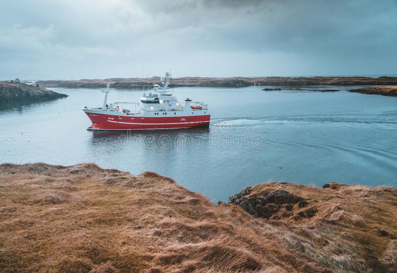 Grundarfjordur, Iceland - 03 January 2019: Harbor with motionless boats during the twilight of the afternoon, Kirkjufell stock photo