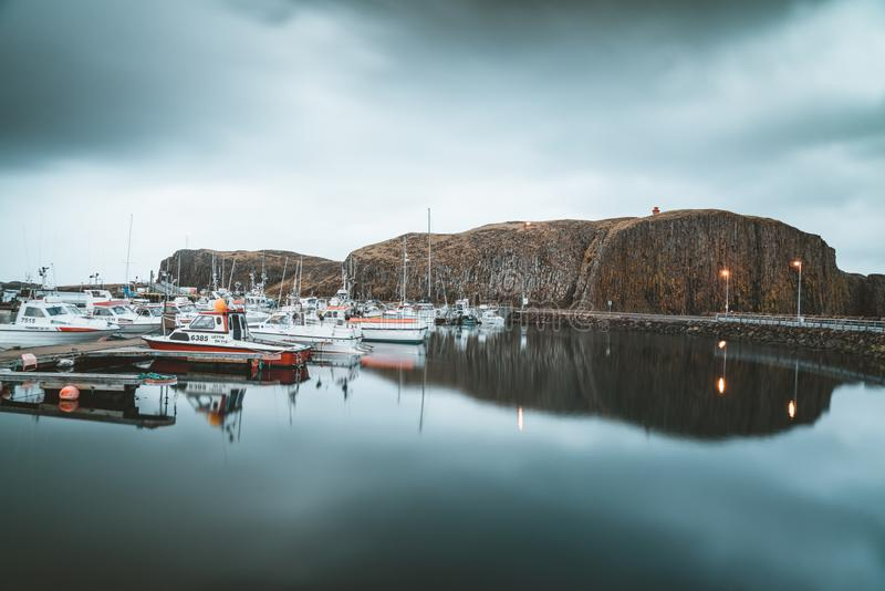 Grundarfjordur, Iceland - 03 January 2019: Harbor with motionless boats during the twilight of the afternoon, Kirkjufell stock photos