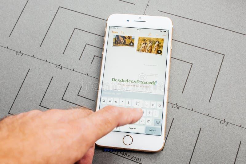 Grundtanke App på den Apple iPhonen plus applikationprogramvaran arkivfoto