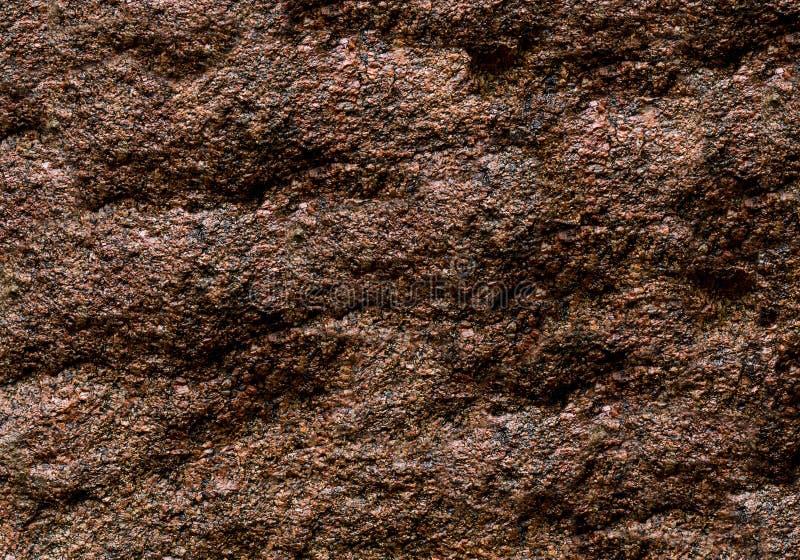 Grunge части стены естественной предпосылки камня темного коричневого цвета неровный выдержанный стоковая фотография rf