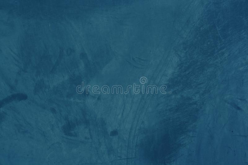 Grunge and abstract and dark blue tone background with pattern and texture of cement. For wallpaper stock photography
