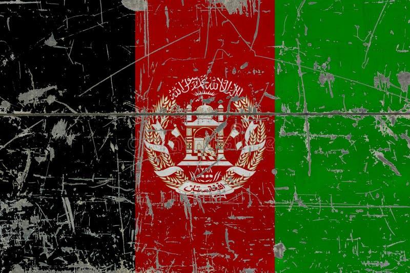 Grunge Afghanistan flag on old scratched wooden surface. National vintage background stock photo