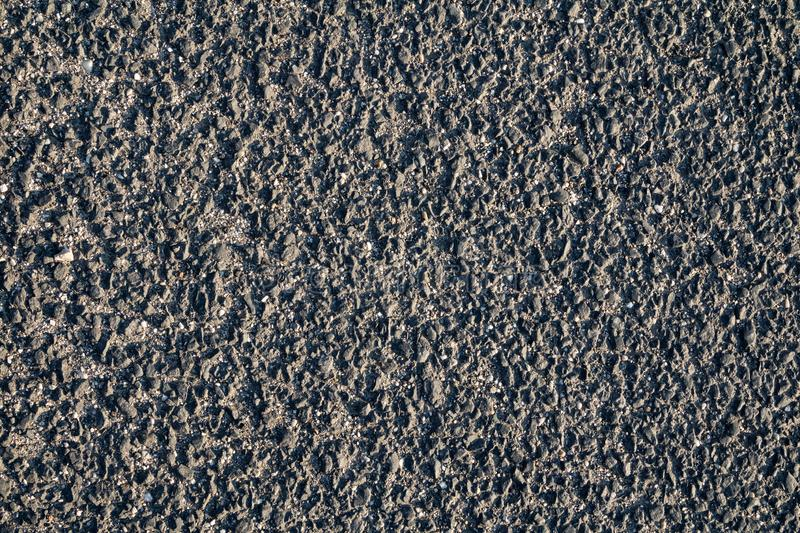 Grunge aged gravel ground surface texture in poor condition stock photos