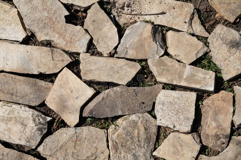 Grunge aged stone ground surface texture in poor condition royalty free stock image