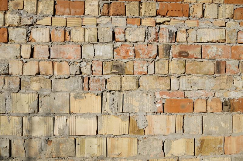 Grunge aged weathered cracked brick wall surface texture in good lights royalty free stock image