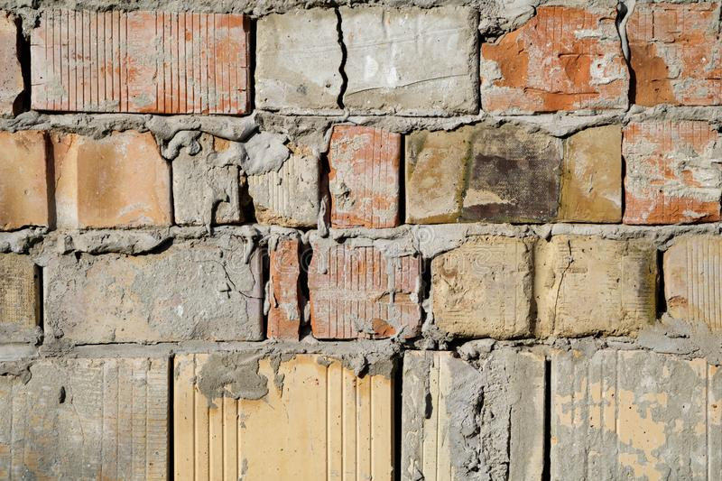 Grunge aged weathered cracked brick wall surface texture in good lights stock image