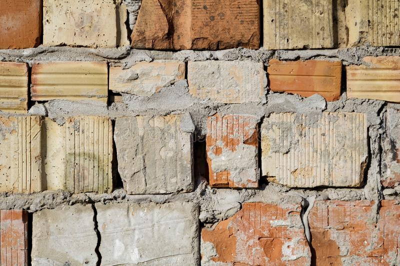 Grunge aged weathered cracked brick wall surface texture in good lights stock photography