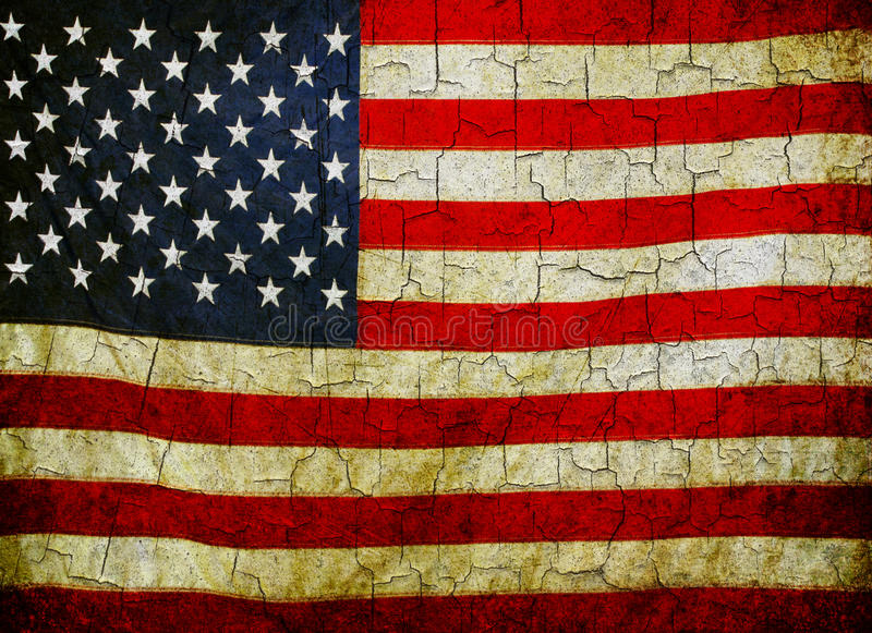 Grunge American flag. American flag on a cracked grunge background stock photos