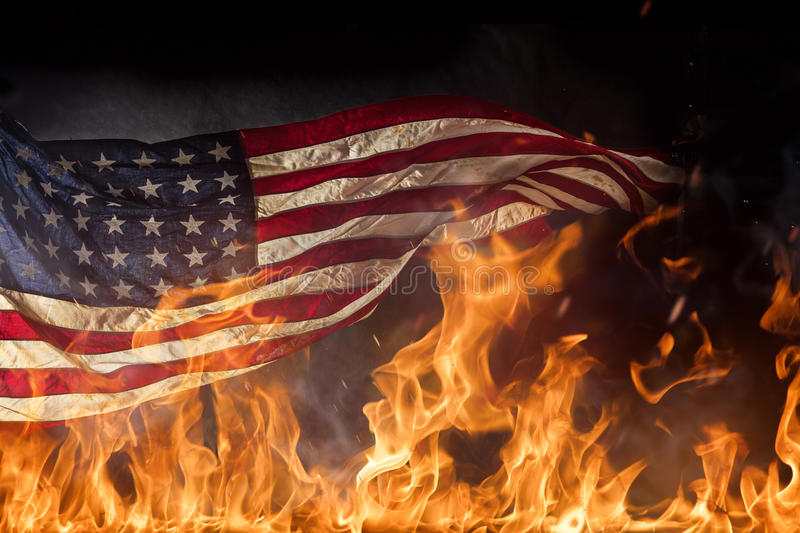 Grunge American flag, war concept. With fire flames, close-up royalty free stock photography