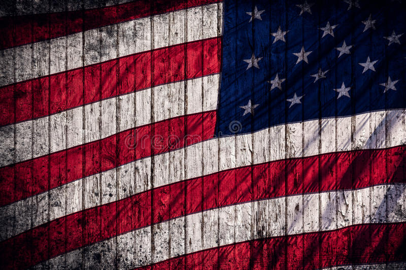 Grunge American Flag. American flag on a grunge wooden background royalty free stock photo