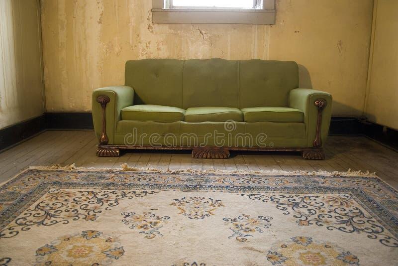 Grunge Apartment Sofa Rug Room Poverty royalty free stock photos