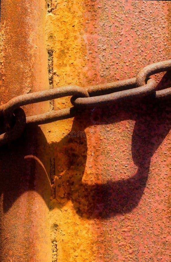 Grunge Background 26. Grunge Background: rusty chain on rusty hull royalty free stock photo