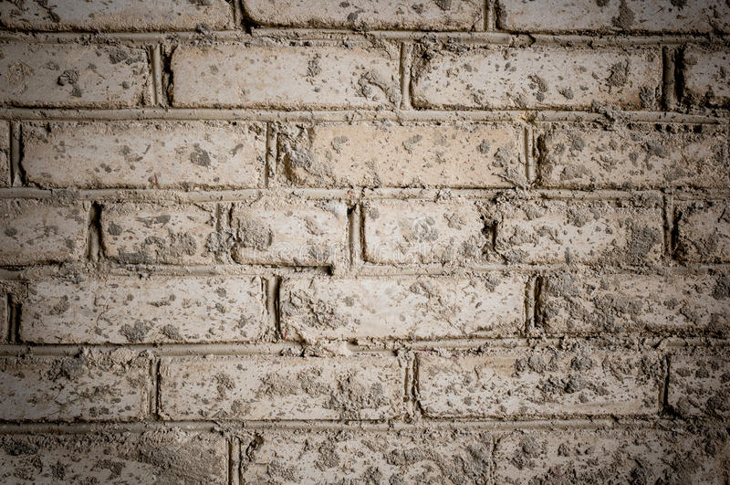 Grunge background. Close-up part of old gray brick wall, stained royalty free stock photo