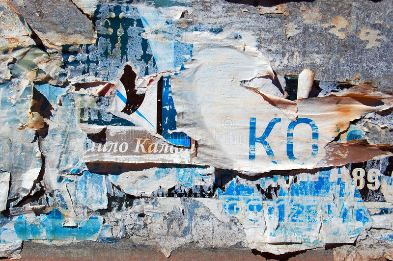 Grunge Background with Old Torn Posters. Wall with Old Torn Posters royalty free stock photos