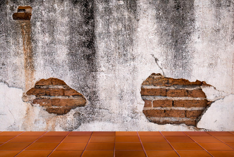 Grunge background, red brick wall texture bright plastered wall. And blocks road pavement abandoned exterior urban background for your concept or project stock photography
