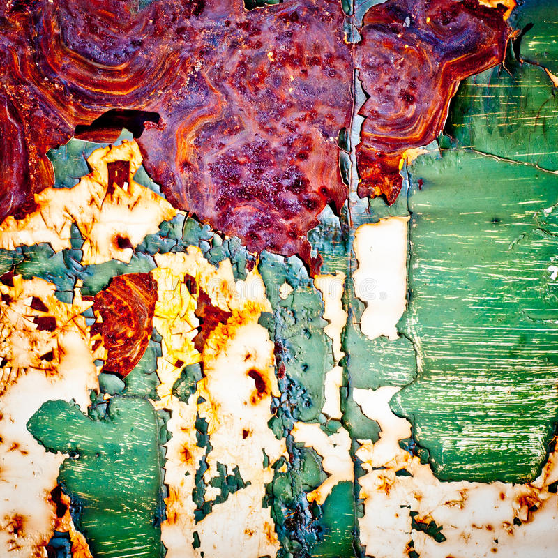 Grunge background. Rusty metal texture. Peeling paint surface. Abstract painting stock photo