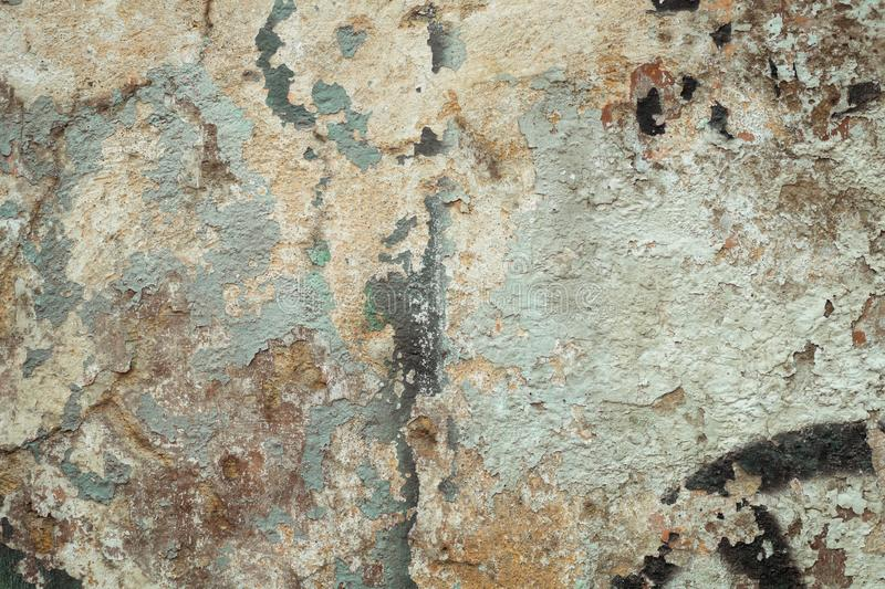 Interesting grunge background old wall. Grunge background texture - old dilapidated multicolored wall on which you can see a lot of layers of previous colors of royalty free stock images