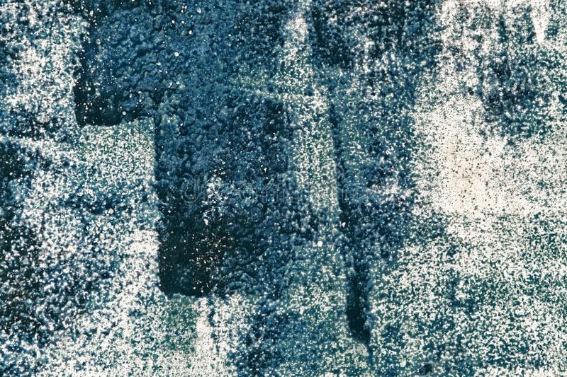 Grunge background of weathered iron with blue and white paint stock photography