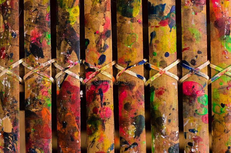 Grunge Bamboo Bars Texture with Colors Spatter for Abstract Background. Image of grunge colorful spatters on bamboo bars texture for background, website, banner stock image