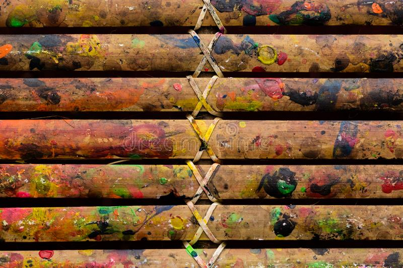 Grunge Bamboo Bars Texture with Colors Spatter for Abstract Background. Image of grunge colorful spatters on bamboo bars texture for background, website, banner royalty free stock photography