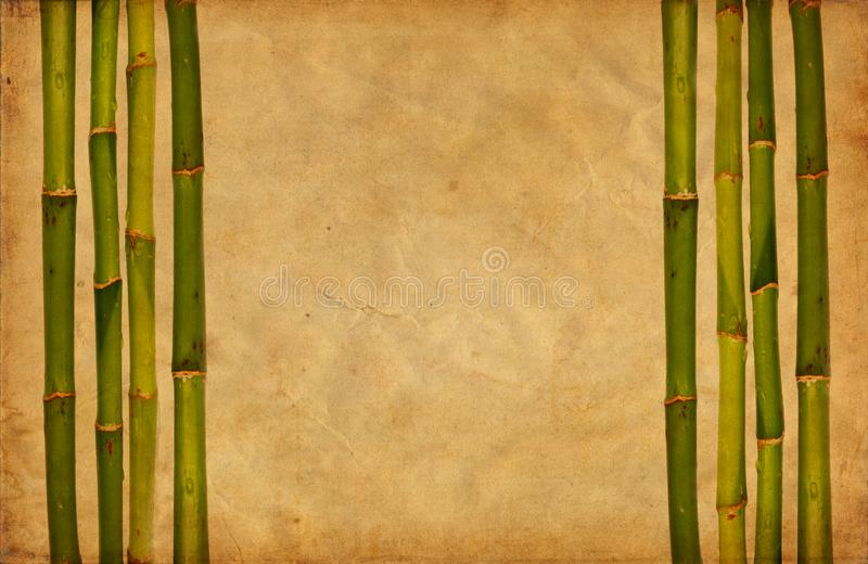 Grunge bamboo and paper background royalty free stock image